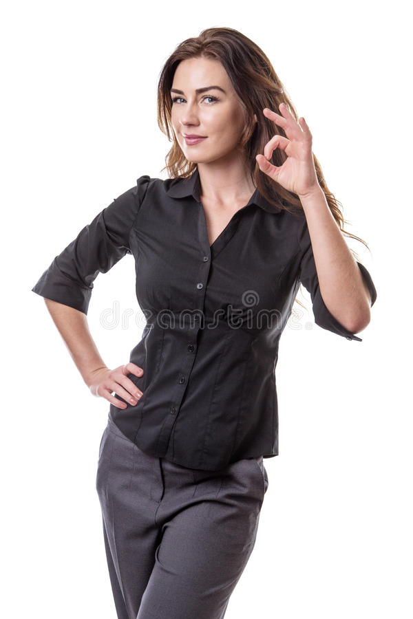 Woman making Ok sign. Pretty young woman making Ok sign with her left hand, whilst her right hand is on her hip. Isolated on white background stock photography