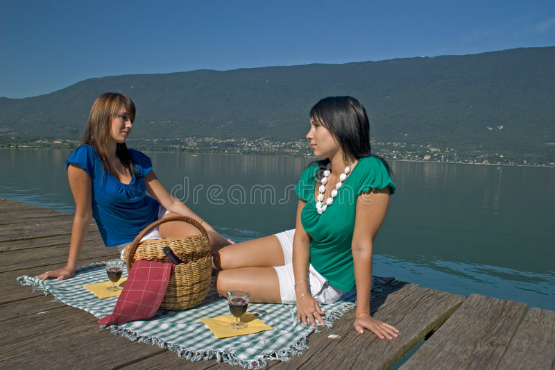 Woman making a picnic stock photos