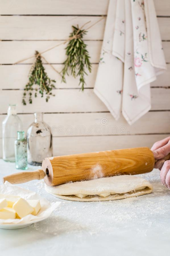 A Woman Making Puff Pastry Dough royalty free stock image