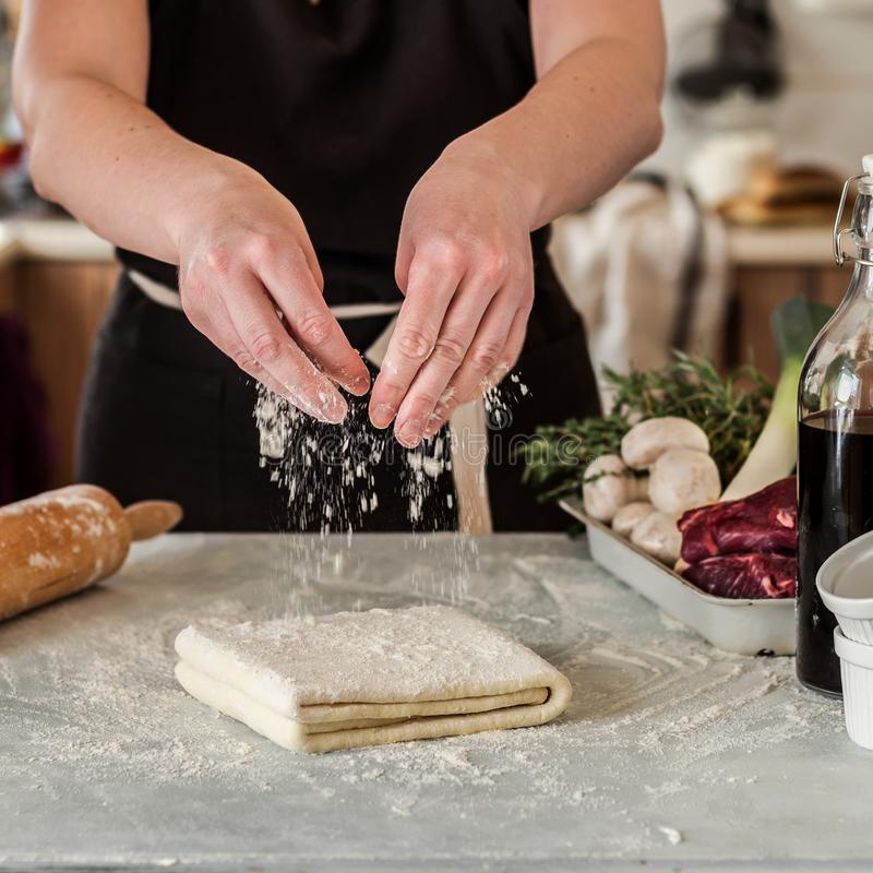 A Woman Making Puff Pastry Dough royalty free stock images