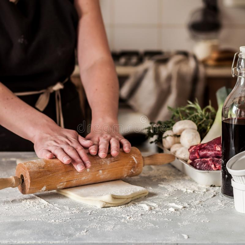 A Woman Making Puff Pastry Dough stock images