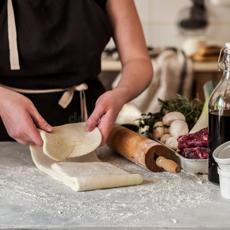 A Woman Making Puff Pastry Dough royalty free stock photo