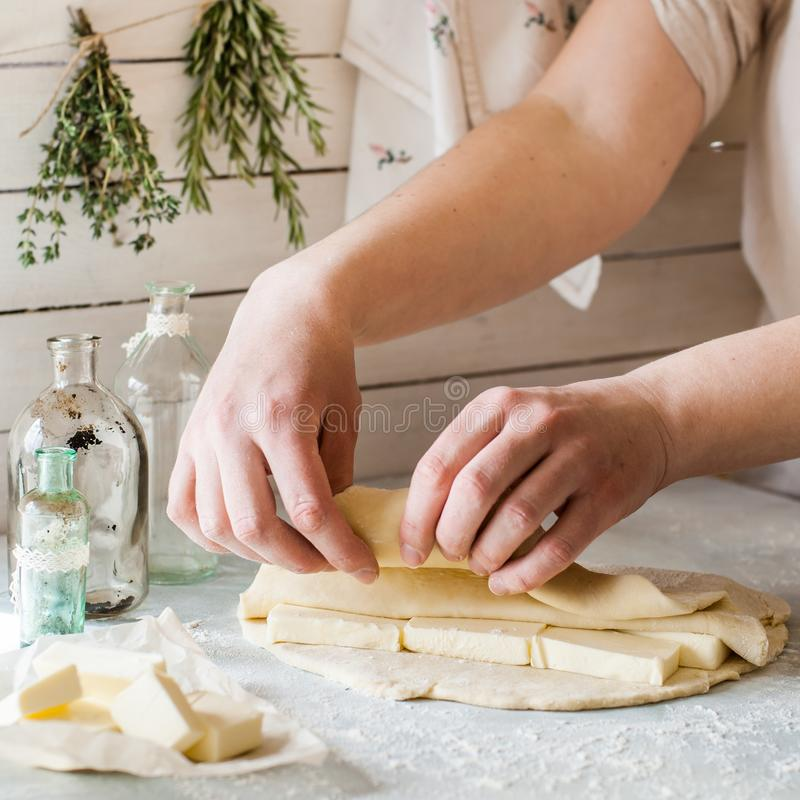 A Woman Making Puff Pastry Dough stock photography