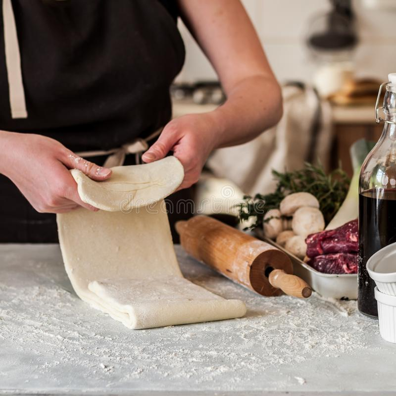 A Woman Making Puff Pastry Dough royalty free stock photos