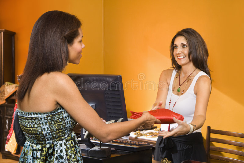 Woman making purchase. royalty free stock photo