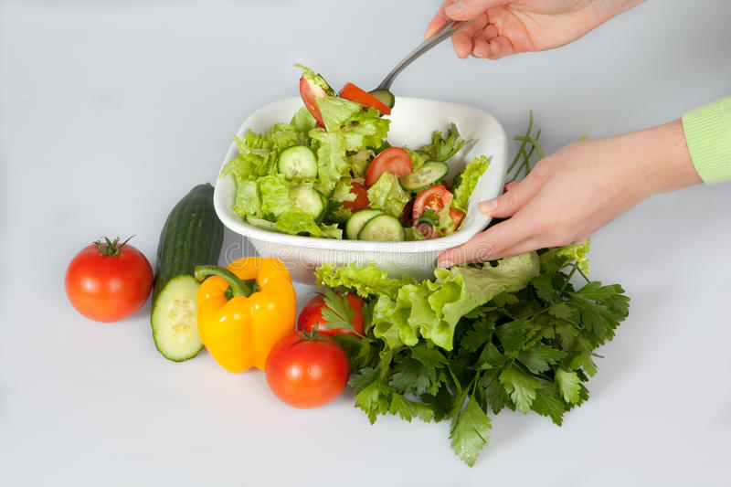 Woman making salad royalty free stock photography