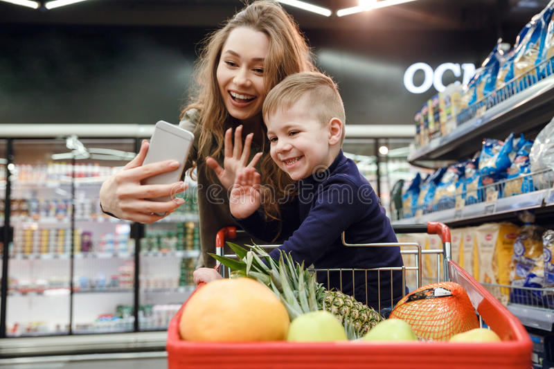 Woman making selfie with her son royalty free stock photos
