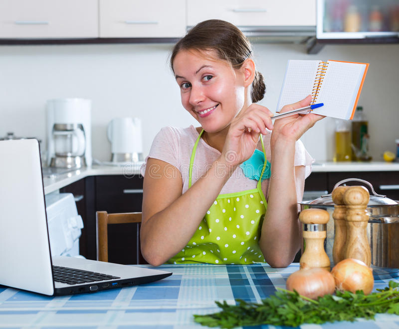 download woman making shopping list at kitchen stock photo image of apron home