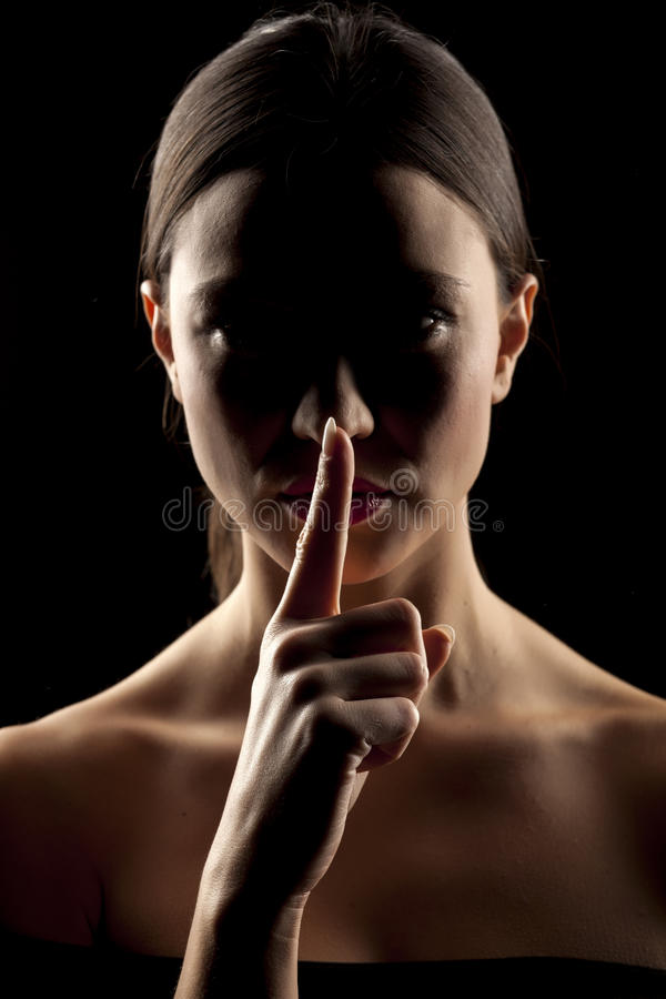 Woman making silence gesture royalty free stock image