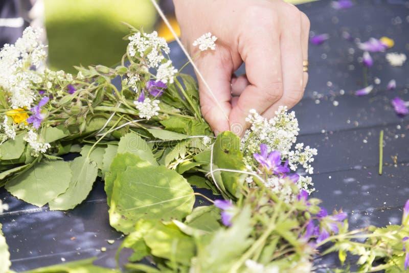 Woman Making a Swedish Midsummer Head Creation.  royalty free stock images