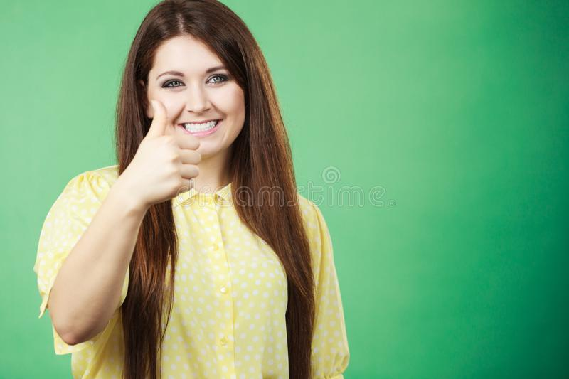 Woman making thumb up gesture stock photo