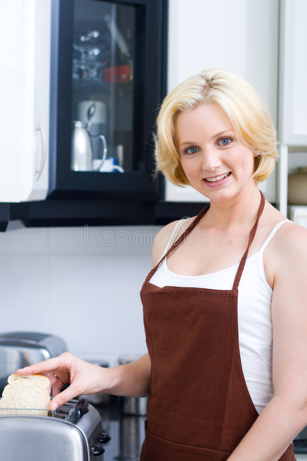 Download Woman making toast stock photo. Image of interior, beauty - 7578466