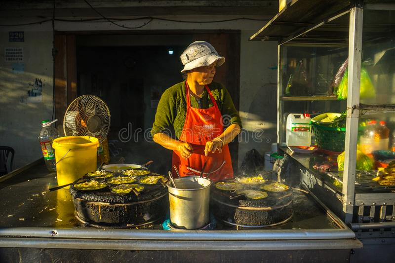 Da lat, lam dong, viet nam- feb 12, 2017: The woman making vietnamese pancake royalty free stock image