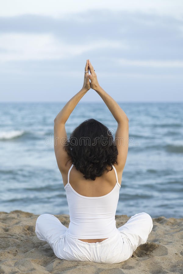 Download Woman Making Yoga Exercise On The Beach Stock Image - Image: 10036941