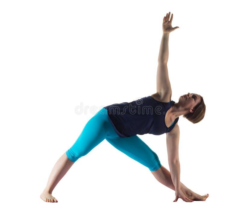 Woman making yoga exercise stock photography