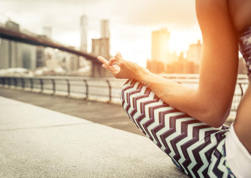Woman making yoga position in New york city. royalty free stock photos