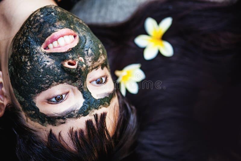 Woman makng black clay mask. Caucasian woman makng black clay mask royalty free stock photography