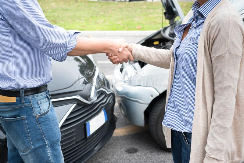 Woman and man agreement after car crash accident. Woman and man agreement after a car crash accident royalty free stock image