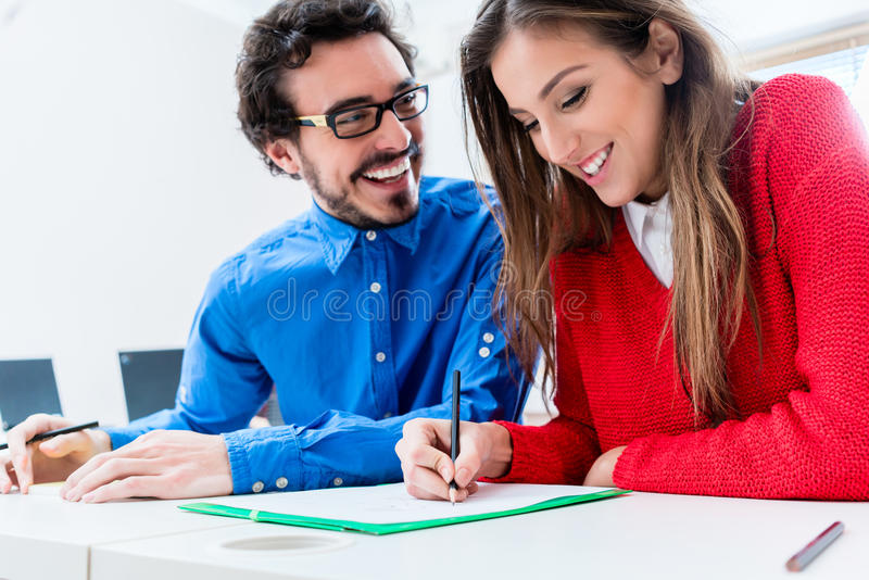 Woman and man as students working together royalty free stock photo