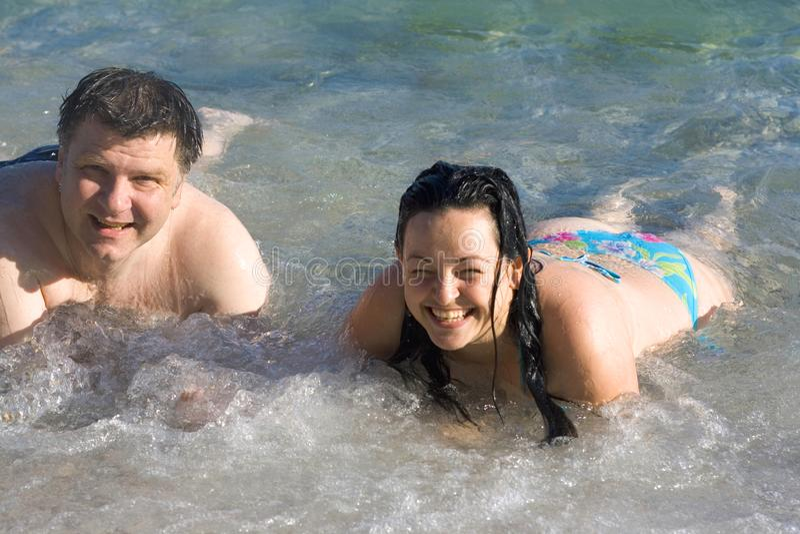 Woman and man on the beach stock photos