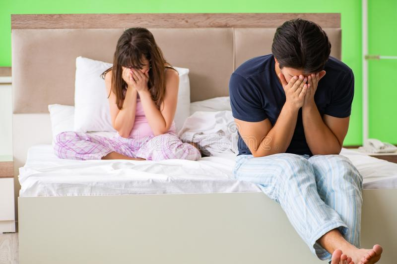 The woman and man in the bedroom after conflict. Woman and men in the bedroom after conflict stock images