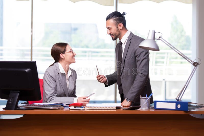 The woman and man in the business concept stock image