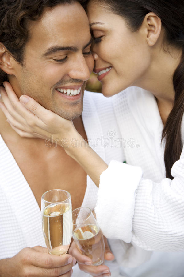 Woman and a man celebrating with champagne and being affectionate stock image