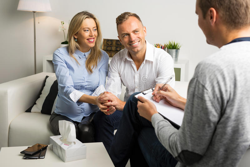 Woman and man at couples therapy stock photos