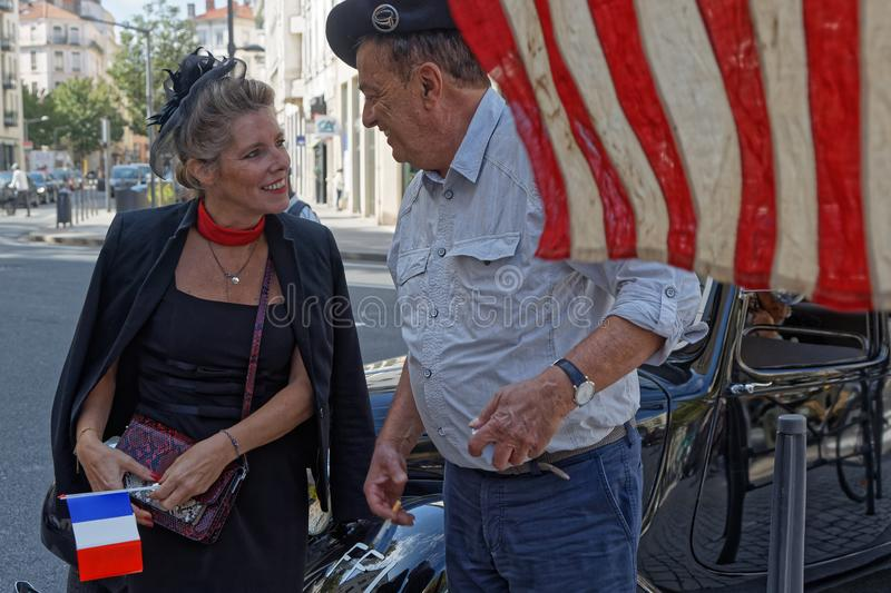 Woman and man discuss under a US flag royalty free stock photos