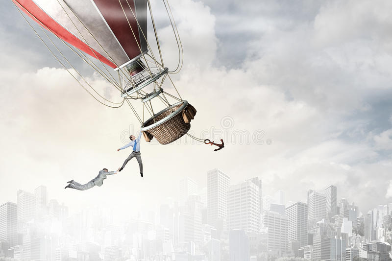 Woman and man flying on aerostat. Young businesswoman and men flying high in sky on colorful aerostat stock images