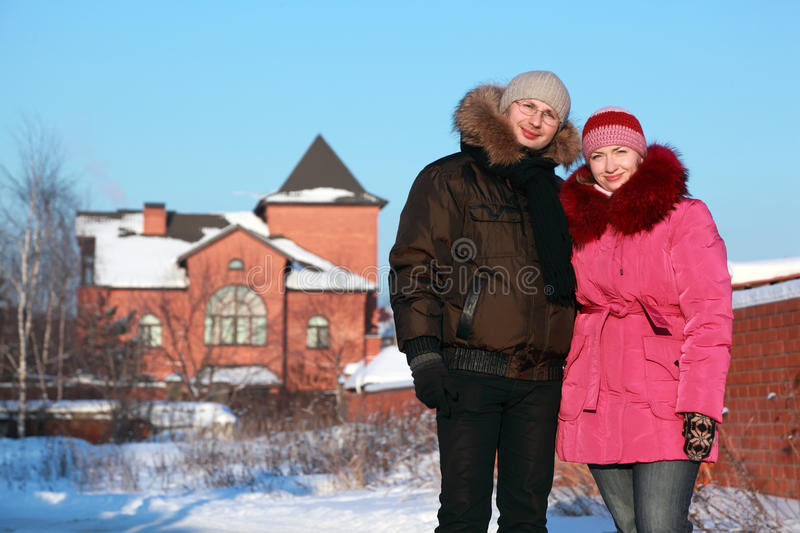 Woman and man in glasses standing outdoors stock images