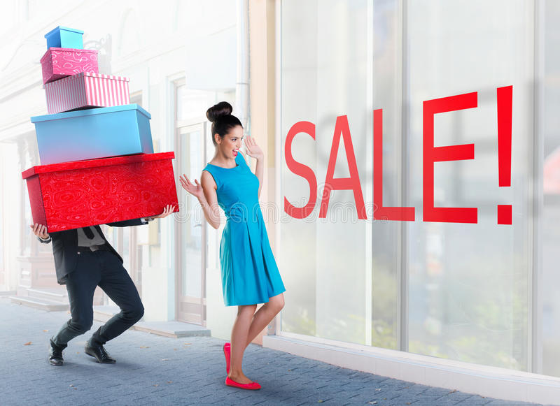 Woman and man going shopping. Woman and men going shopping downtown stock images