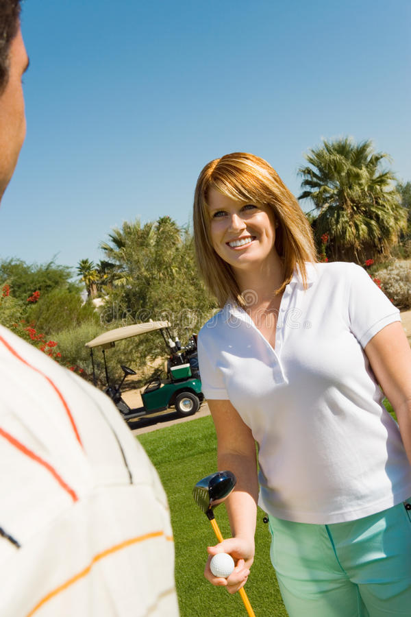 Woman With Man At Golf Course stock images