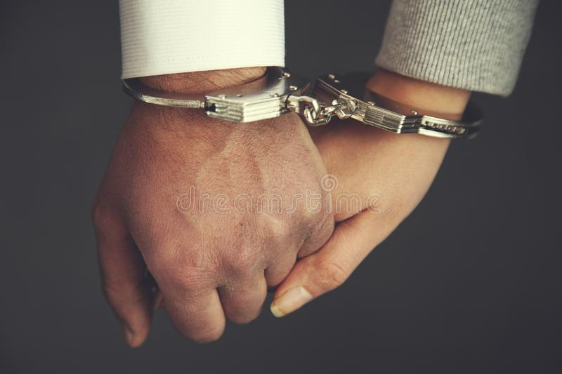 Couple hand handcuffs stock images