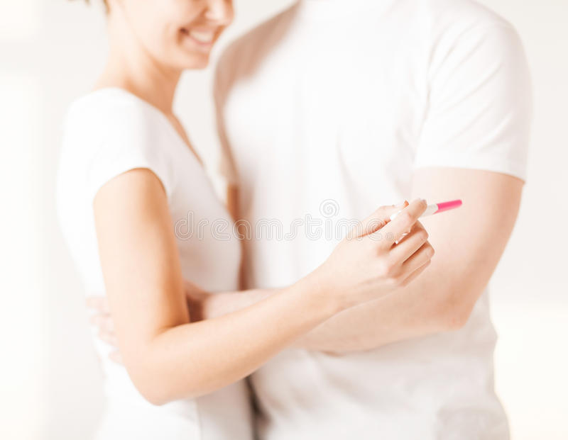 Woman And Man Hands With Pregnancy Test Stock Photography