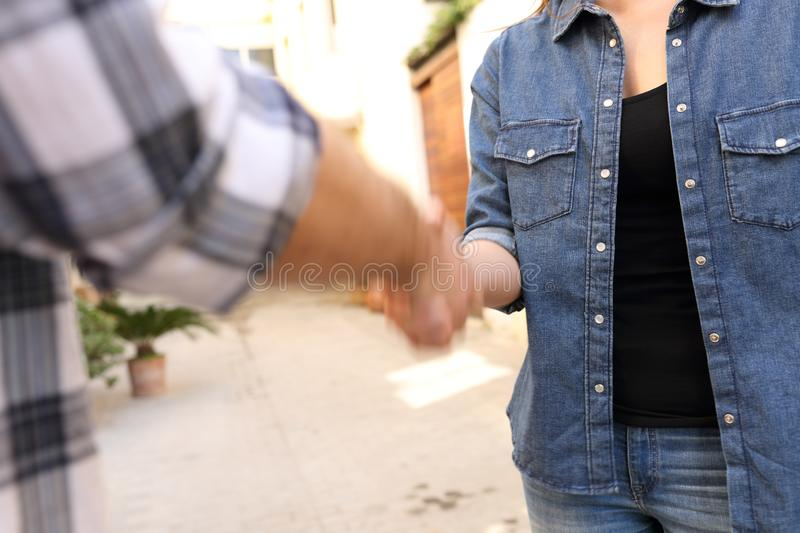 Woman and man handshaking in the street after deal. Close up of a women and men handshaking in the street after deal royalty free stock photos