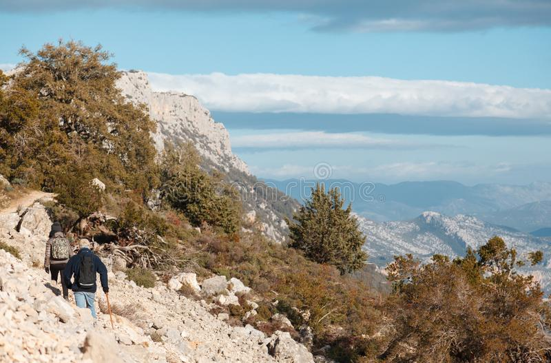 Woman and man hiking in the trail to Gola su gorroppu - activity. And health concept stock image