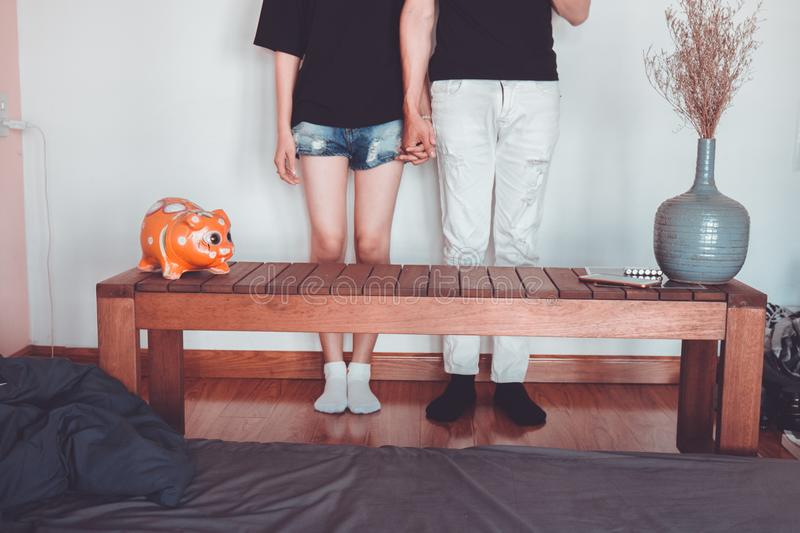 Woman and Man Holding Hand Standing Near Brown Coffee Table Inside Room royalty free stock photo