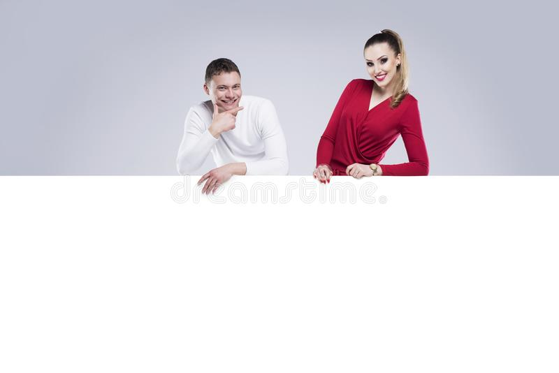 Woman and a man are holding a white banner stock photography