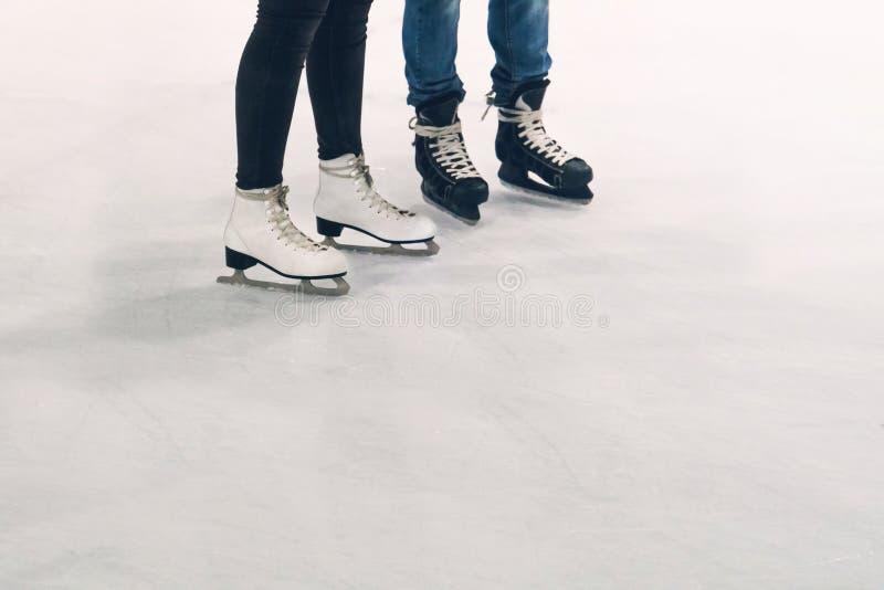 Woman and man ice skating. royalty free stock photography
