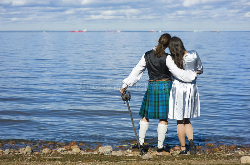 Download Woman And Man Looking At The Sea Stock Photo - Image of girl, alba: 21597574