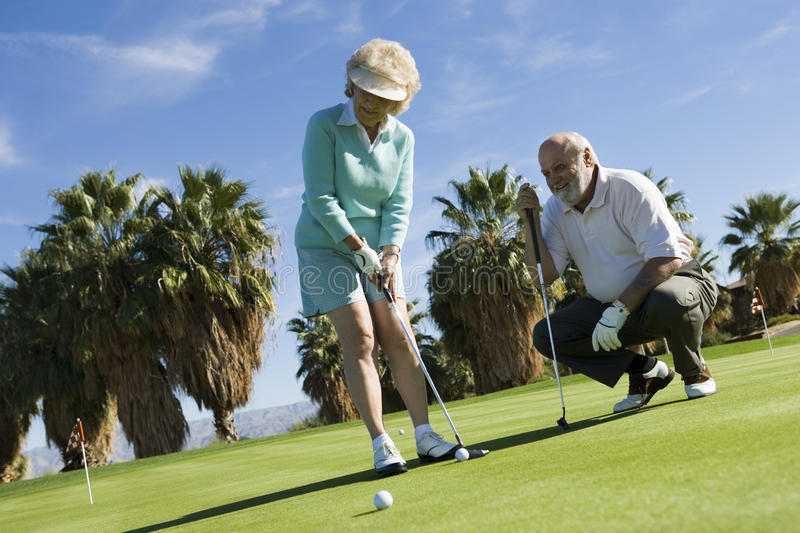 Woman And Man Playing Golf royalty free stock photo