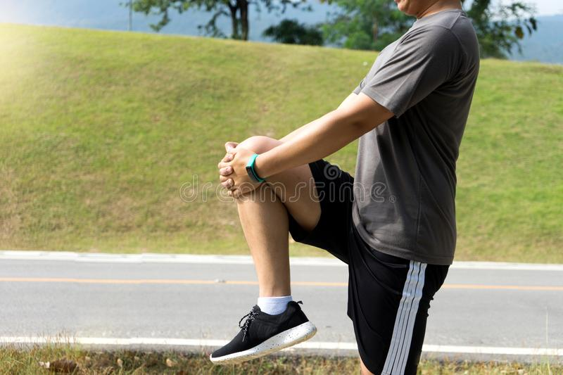 Woman man prepare for exercise warm up body leg berfore sport jo. Gging and fitness outdoor stock image