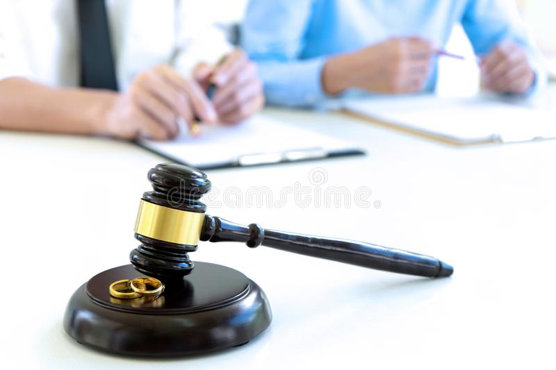 woman and man quarrel in front of gavel royalty free stock images