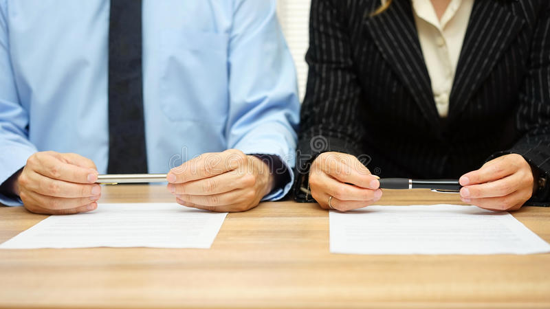 Woman and man are reading agreement on meeting.  royalty free stock images