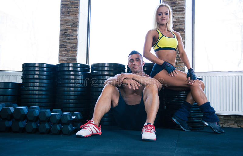 Woman and man resting in gym royalty free stock photos