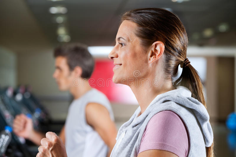 Download Woman And Man Running On Treadmill Stock Photo - Image: 36832632