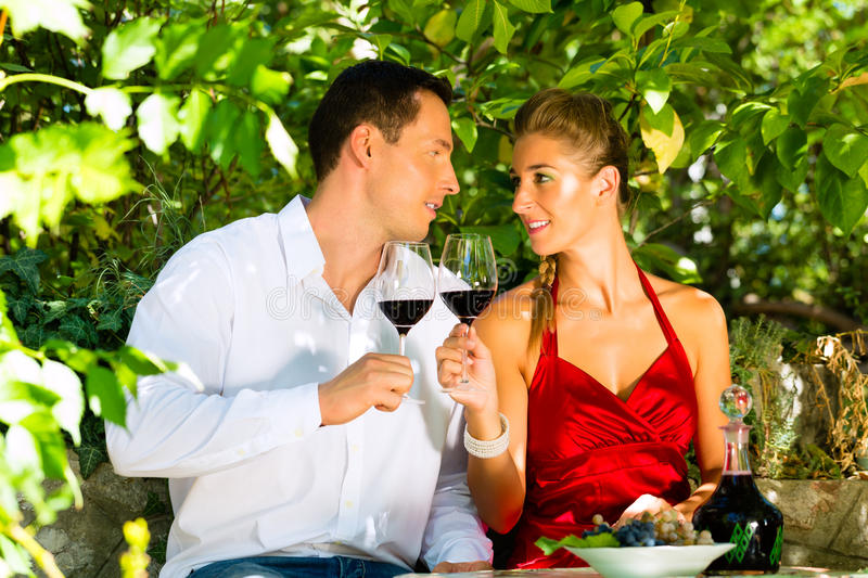 Download Woman And Man Sitting Under Grapevine And Drinking Royalty Free Stock Images - Image: 27225359