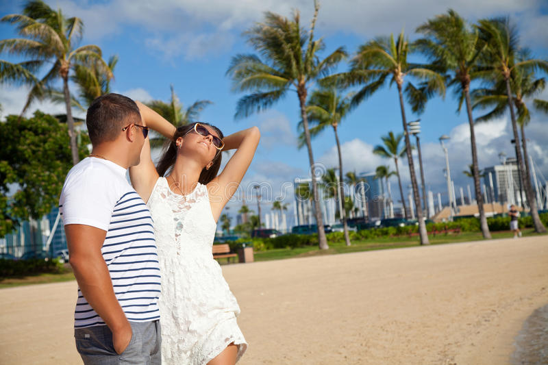 Woman and man smiling happy on beach on Hawaii stock photo