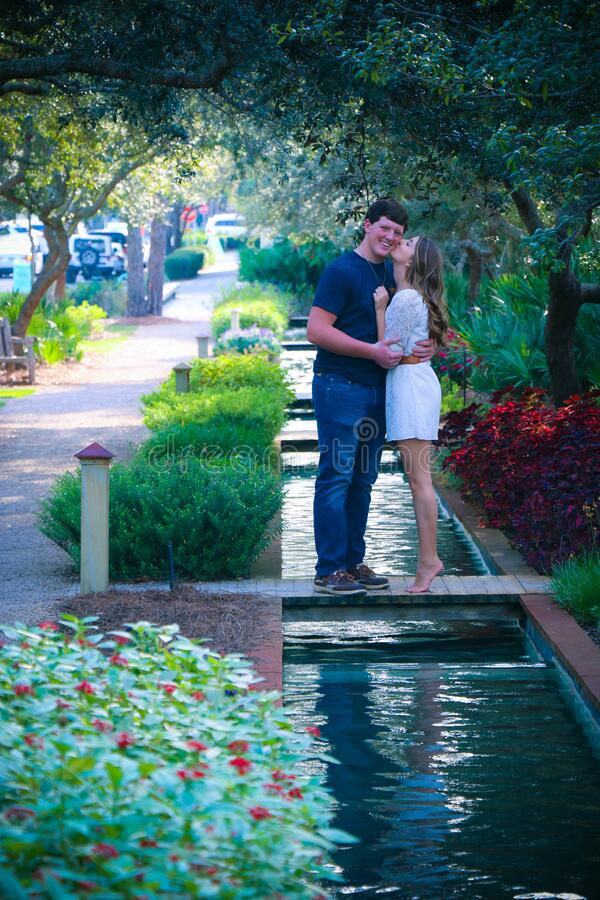 Woman and Man Standing on Bridge Kissing royalty free stock photography